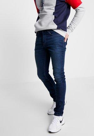STEVE SLIM TAPERED - Zúžené džíny - dark-blue denim