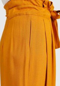 khujo - EIVOLA - Trousers - yellow - 5