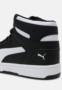 Puma - REBOUND LAYUP UNISEX - High-top trainers - black/white - 6