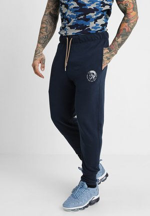 UMLB-PETER TROUSERS - Tracksuit bottoms - blau
