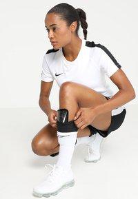 Nike Performance - MERCURIAL LITE - Shin pads - black/white - 1