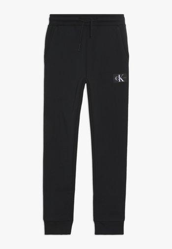 MONOGRAM SWEATPANTS - Teplákové kalhoty - black