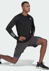 adidas Performance - OWN THE RUN LONG-SLEEVE TOP - Sports shirt - black - 1