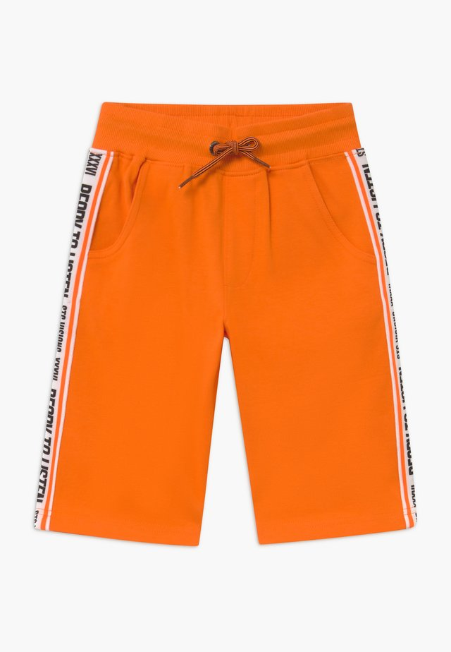BERMUDAS KID - Tracksuit bottoms - orange