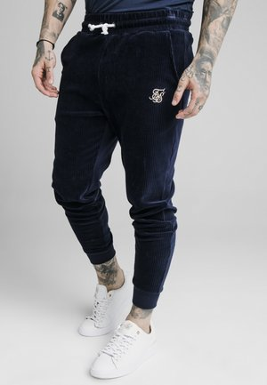ALLURE CUFFED PANTS - Verryttelyhousut - navy