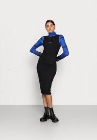 Calvin Klein Jeans - RIB ZIP DRESS - Žerzejové šaty - black - 1