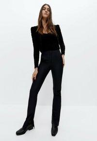 Uterqüe - Trousers - black - 1