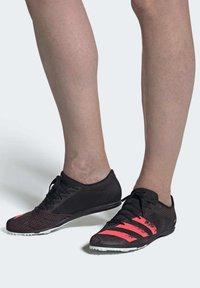 adidas Performance - DISTANCESTAR SPIKES - Trail running shoes - black - 1
