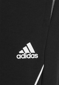 adidas Performance - FAVS  - Tracksuit bottoms - black/white - 4