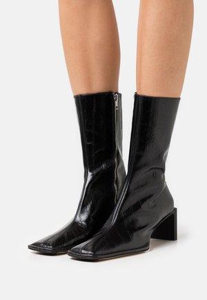 ANITHA - Støvler - black