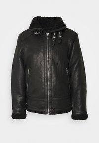 AUSTIN - Leather jacket - black