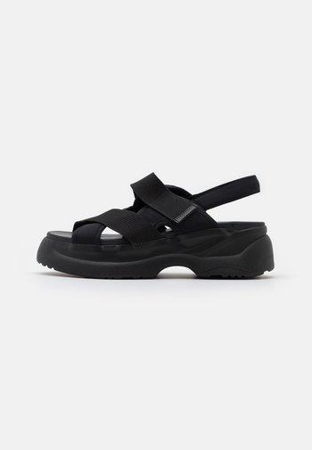 ESSY - Platform sandals - black