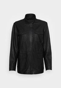 JACKET POCKETS - Leather jacket - black