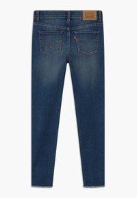 Levi's® - 710 SKINNY ANKLE - Jeans Skinny Fit - blue denim - 1