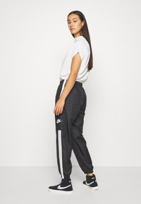 Nike Sportswear - PANT  - Tracksuit bottoms - black/white - 2