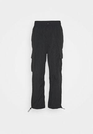 JUNO JOGGERS - Pantaloni - black