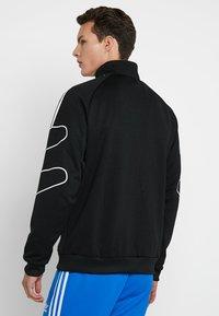 adidas Originals - FSTRIKE - Chaqueta de entrenamiento - black - 2