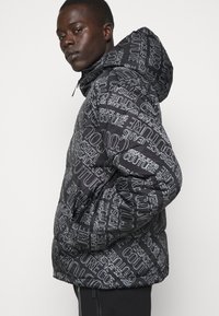 Versace Jeans Couture - QUILTED JACKET - Down jacket - nero - 4