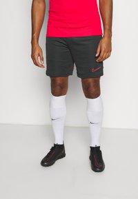Nike Performance - SHORT - Sports shorts - black/siren red - 0