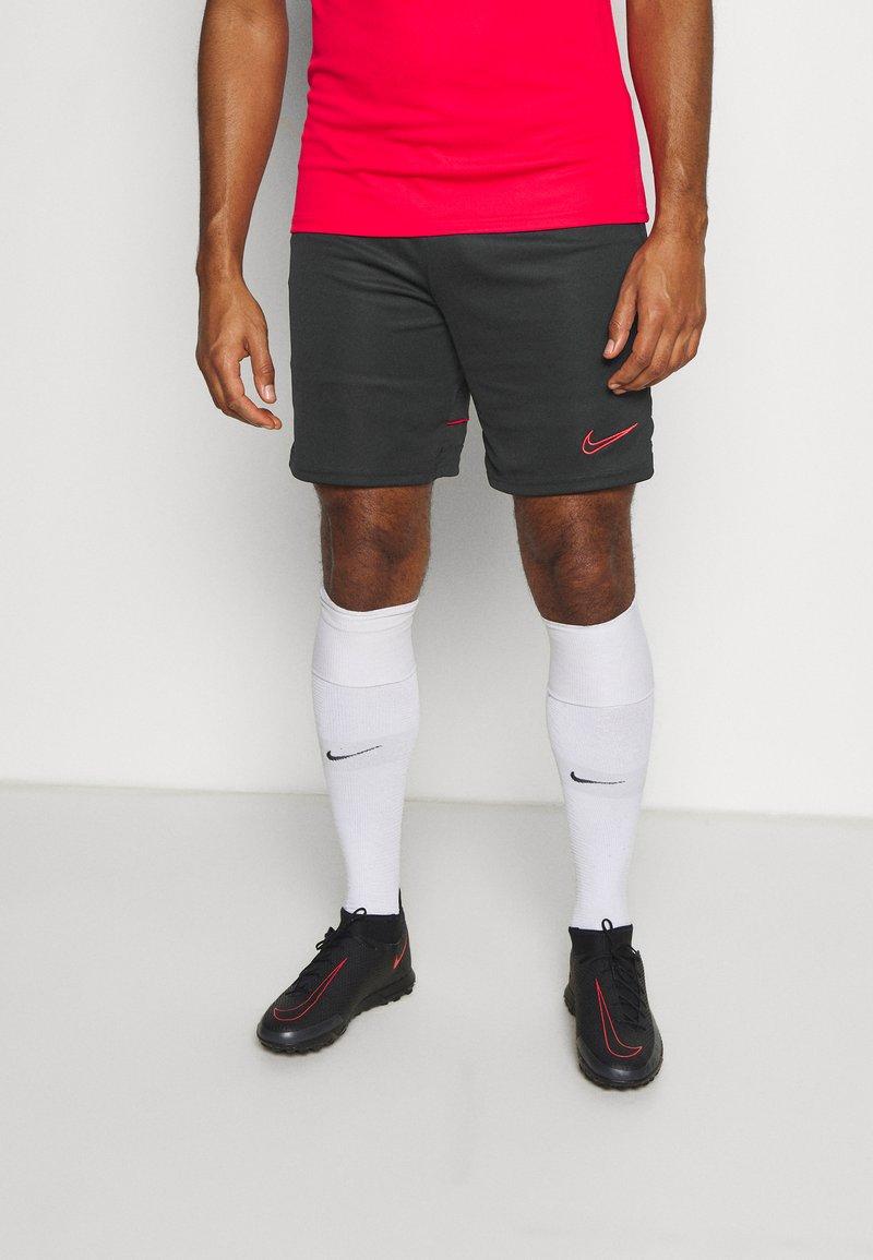 Nike Performance - SHORT - Sports shorts - black/siren red