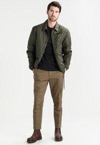 Timberland - CREW CHEST - Basic T-shirt - black - 1