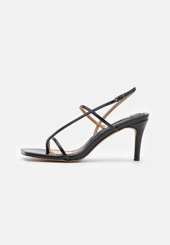 STRAPPY  - T-bar sandals - black