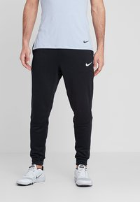 Nike Performance - DRY TAPERED PANT - Tracksuit bottoms - schwarz - 0