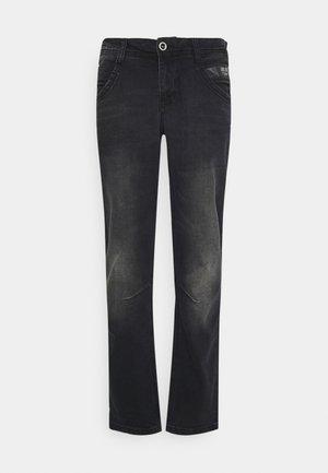 TAPERED - Straight leg jeans - black