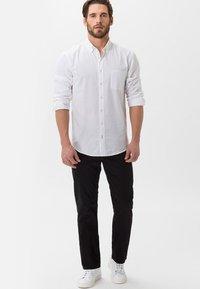BRAX - STYLE COOPER - Straight leg jeans - perma black - 1