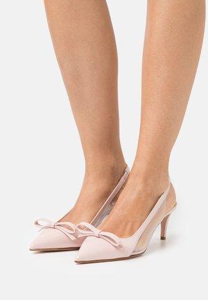Classic heels - nude/trasparente