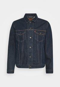 THE TRUCKER - Denim jacket - med indigo