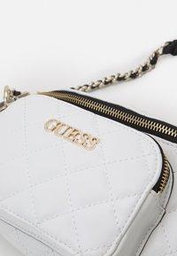 Guess - ILLY CROSSBODY BELT BAG - Bum bag - white multi - 4