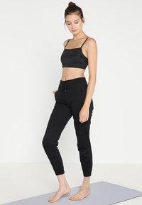 Filippa K - SHINY TRACK PANTS - Teplákové kalhoty - black - 1