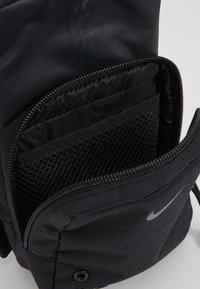 Nike Performance - KYRIE IRVING FESTIVAL BAG - Across body bag - black/dark smoke grey - 3