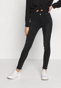 ONLY Petite - ONLCHRISSY   - Jeans Skinny Fit - black - 0