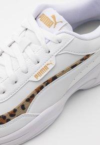 Puma - CILIA MODE LEO - Trainers - white/team gold/black - 6