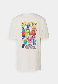 Puma - DOWNTOWN GRAPHIC TEE - T-Shirt print - eggnog - 1