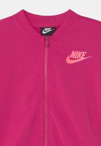 Nike Sportswear - SET - Tepláková souprava - fireberry/sunset pulse - 3