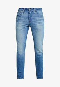 512™ SLIM TAPER FIT - Slim fit jeans - blue denim