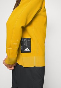 adidas Performance - ATHLETICS TECH SPORTS - Sweter - legacy gold - 3
