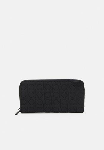 LONG ZIPAROUND MONO UNISEX - Wallet - black