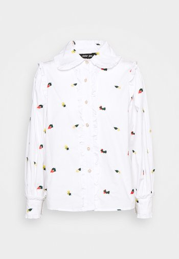 POSY EMBROIDERED RUFFLE BLOUSE
