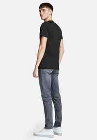 Jack & Jones - JJECORP LOGO TEE O-NECK - T-shirt con stampa - black - 2