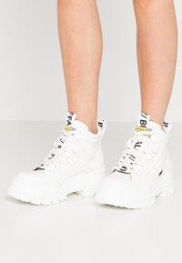 Buffalo - VEGAN ASPHA MID - Platform ankle boots - white - 0