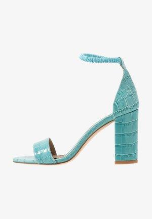 High heeled sandals - flavio turquesa