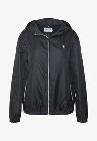 Calvin Klein Jeans Plus - PLUS LARGE CK HOODED ZIP THROUGH - Training jacket - black - 4
