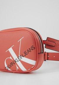 Calvin Klein Jeans - ROUNDED WAISTBAG - Bum bag - orange - 2