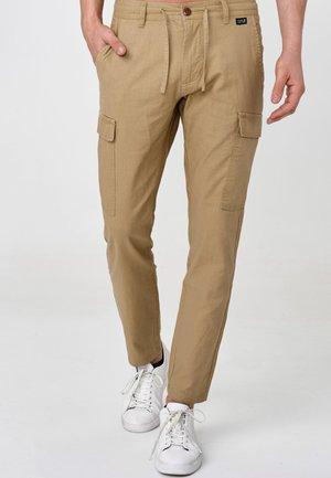 CAGLE - Cargo trousers - cornstalk