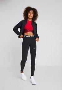 Nike Performance - INTERTWIST CROP TANK - Top - gym red/team red - 1