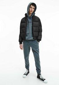 Calvin Klein Jeans - Winter jacket - ck black / mix media - 1